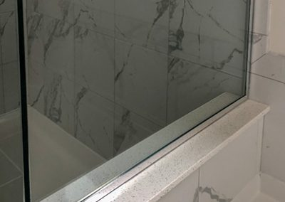 BlueStudio-Bathroom-White-Marbel-Glass-Shower