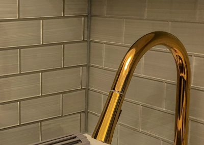 BlueStudio-Kitchen-White-Cabinets-Gold-Faucet-Backsplash