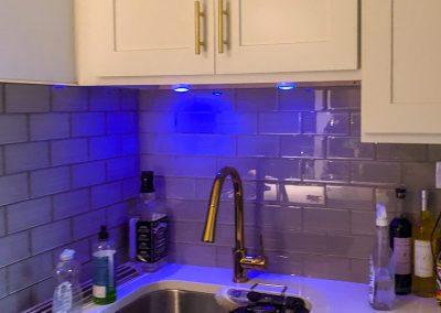 BlueStudio-Kitchen-White-Cabinets-Gold-Handles-Hardware-Faucet-Remodel-Under-Cabinet-Lights